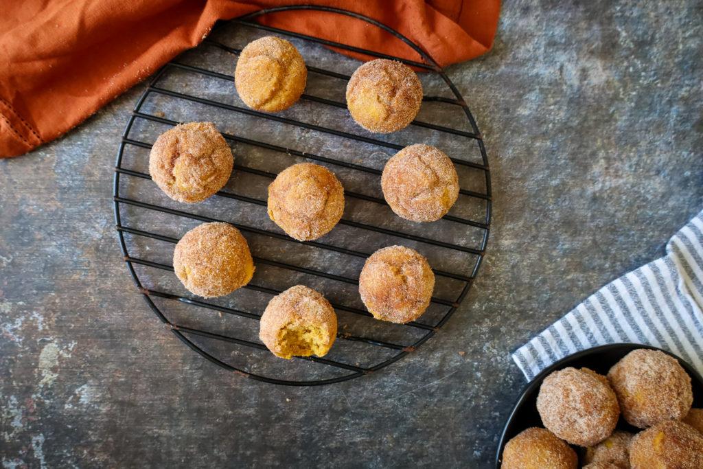 Gluten Free Pumpkin Spice Doughnut Holes on a cooling rack