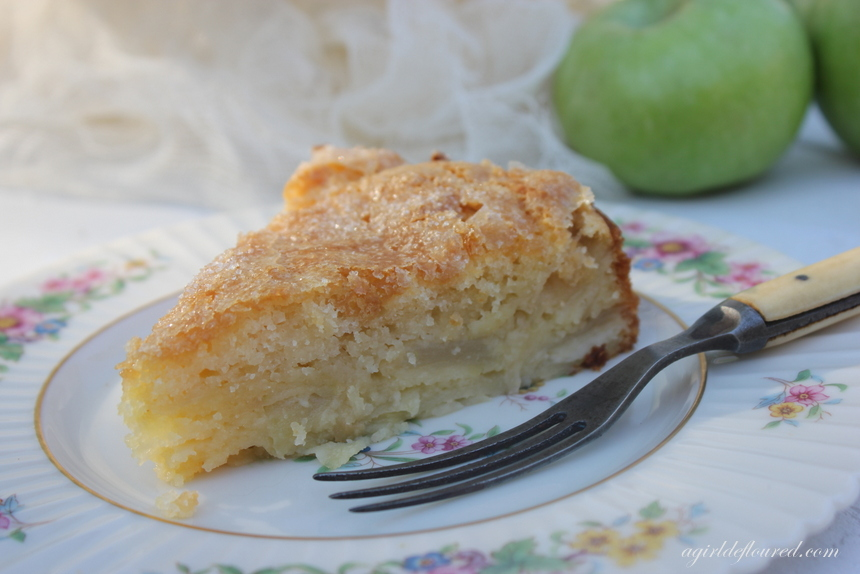 A slice of gluten free French Apple Cake on an antique plate