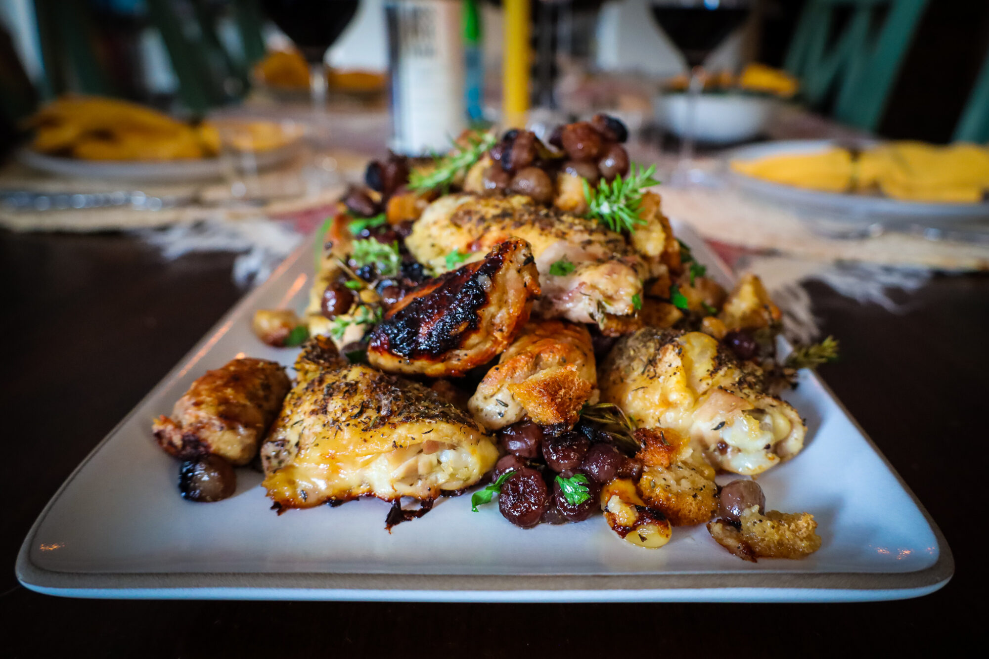 Oven Roasted Chicken Thighs with Sausages and Grapes horizontal image