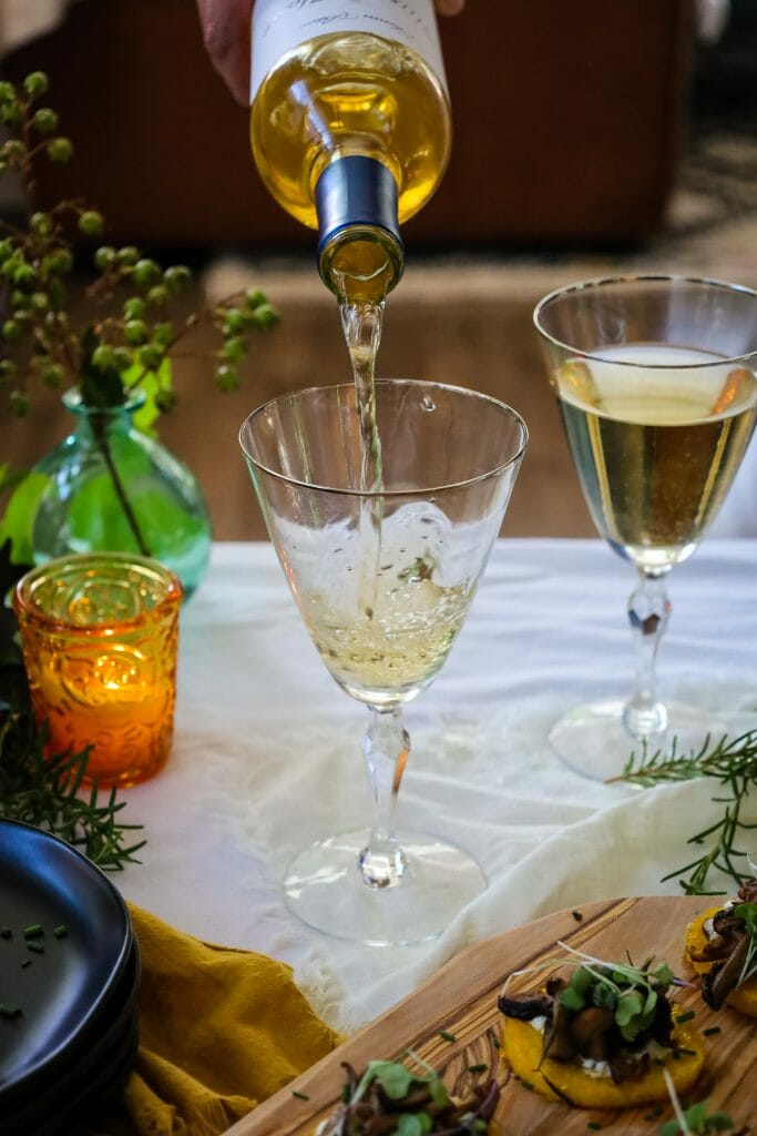 Pouring Chenin Blanc into Wine Glass